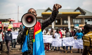 A Lucha supporter speaks during a demonstration at Virunga market in Goma