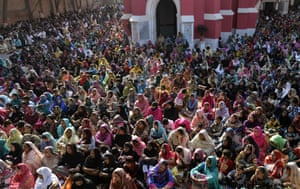 Worshippers attend mass at St Anthony's church in Lahore, Pakistan