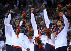 Players from the US men's basketball team – Michael Redd, Kobe Bryant, Dwayne Wade, Lebron James and Deron Williams – celebrate winning the gold medal at the Beijing 2008 Olympic Games.