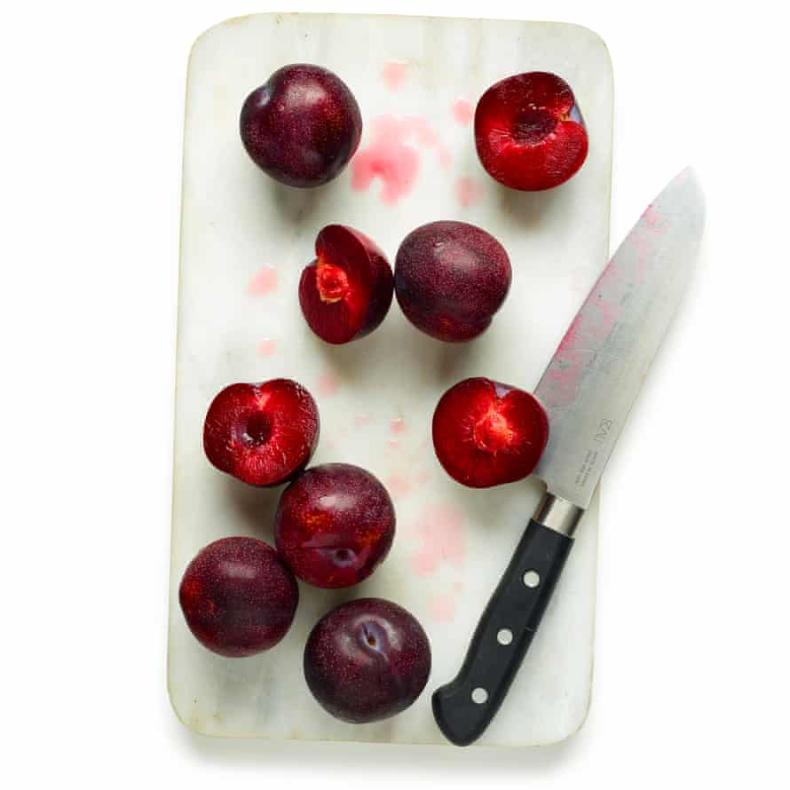 Halve and stone the plums, scatter the dough with the ground almonds then arrange the plums on top.