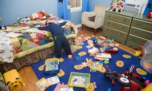 Asian boy in messy bedroom