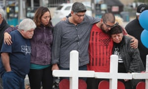 Friends and family of Ricardo and Therese Rodriguez mourn their loss while visiting a memorial to honor the Texas church shooting victims.