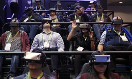 People look through Samsung Gear VR virtual reality goggles at the Samsung booth during CES International, Tuesday, Jan. 9, 2018, in Las Vegas. (AP Photo/John Locher)