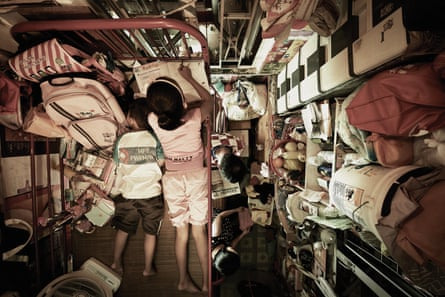 Crammed in … a photograph of Hong Kong life from Benny Lam's Trapped series.