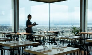 The dining room of The Lookout with a view over the Firth of Forth out of the glass wall