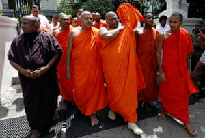 Kandy, Sri Lanka Galagoda Aththe Gnanasara Thero (C), head of the nationalist Bodu Bala Sena ('Buddhist Power Force'), arrives with a group of monks for a convention at the Temple of the Sacred Tooth Relic