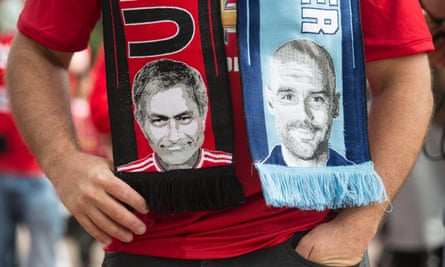 A scarf bearing pictures of José Mourinho and Pep Guardiola