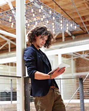 Millennial using iPad at work at high tech office