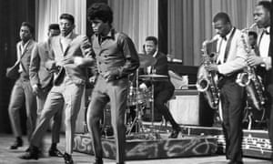 James Brown and the Famous Flames at the Apollo theatre, New York, in 1964.