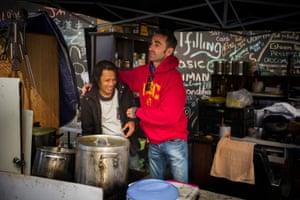 Volunteers in a street kitchen
