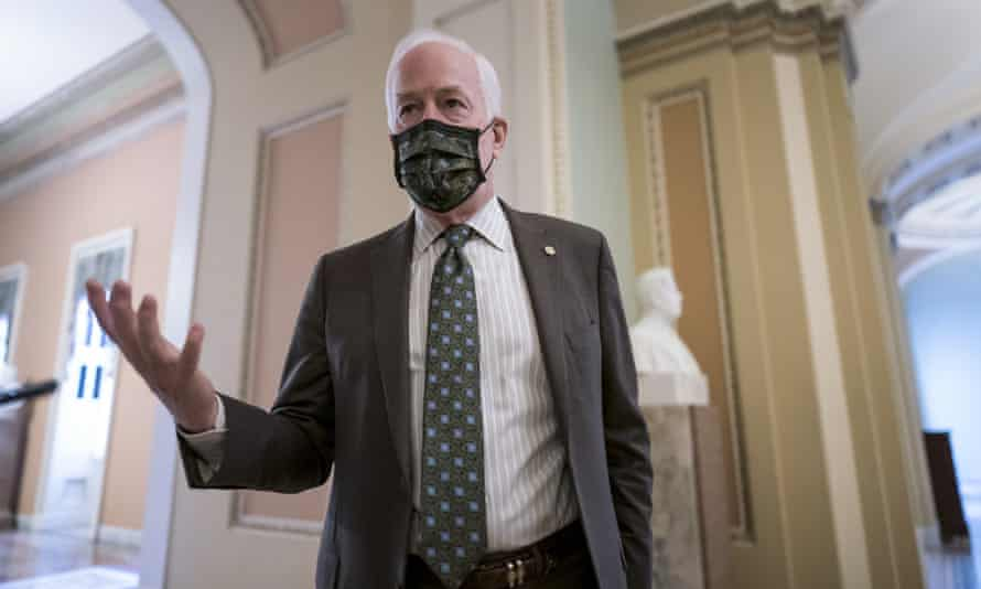 John Cornyn pauses outside the Senate chamber in Washington on Friday.