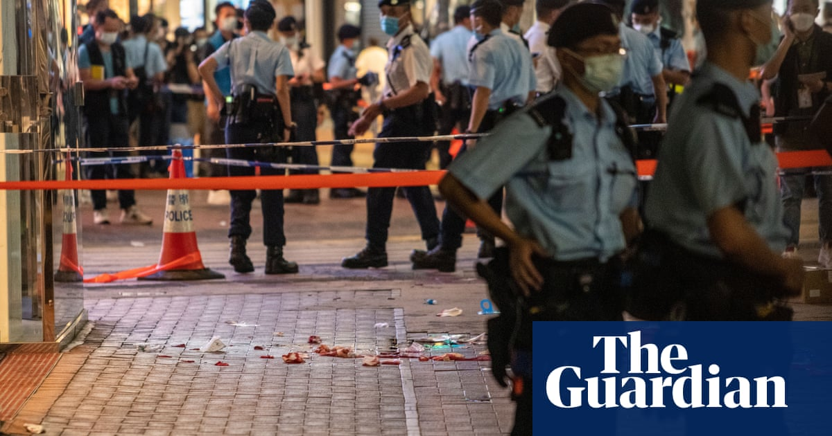 Hong Kong police say mourning officer's attacker is like backing terrorism
