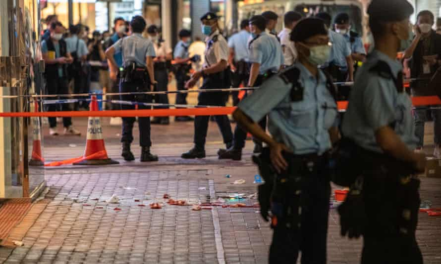 Police at the scene where a man stabbed a police officer in Hong Kong