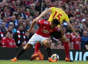 Manchester United's Alexis Sanchez leans on Watford's Craig Cathcart as United win 1-0 at Old Trafford.