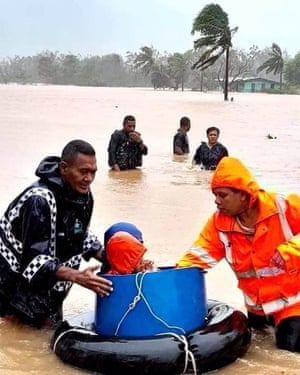 Police rescue children from floodwaters after Cyclone Ana hit Fiji