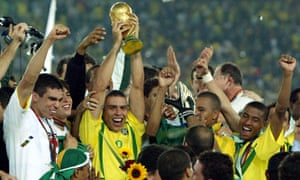 Ronaldo lifts the trophy after Brazil win the 2002 World Cup with a 2-0 victory over Germany.