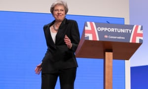 Theresa May robo-gyrates on to the stage at the Tory party conference in Birmingham.
