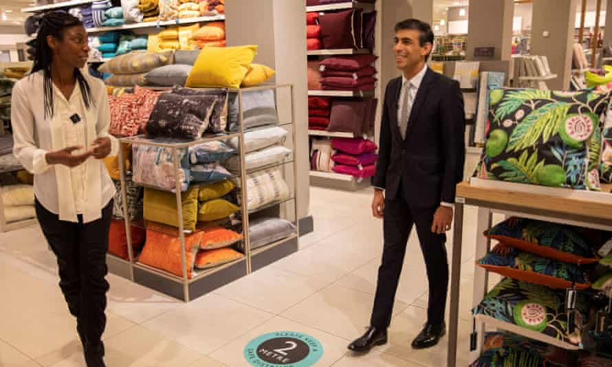 Rishi Sunak (right) with the chair of John Lewis, Sharon White, during a visit to the flagship store in Oxford Street, London.