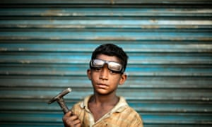 This nine-year-old boy works as an assistant to a carpenter in Dhaka, Bangladesh. A group of academics now claim that allowing young children to work can have positive effects.