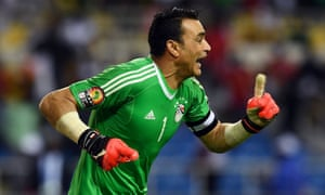 Egypt's goalkeeper Essam El-Hadary celebrates after his two saves turned the penalty shootout his team's way.