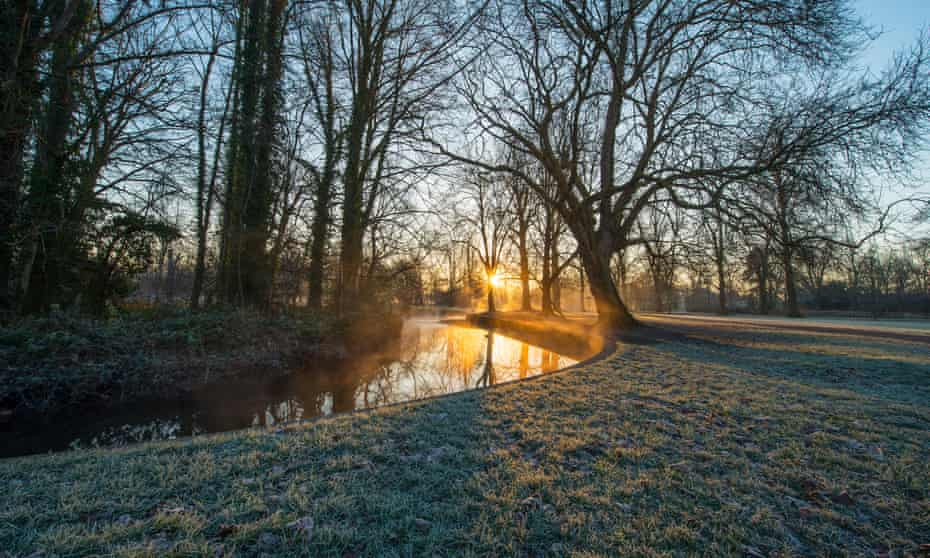 The River Wandle at sunrise at Morden Hall Park, London.
