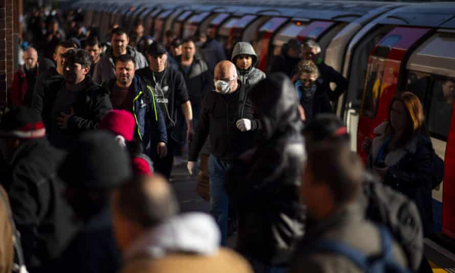 Commuters exit the tube at West Ham station in east London