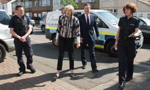 Home secretary Theresa May and prime minister David Cameron meet immigration enforcement officers.