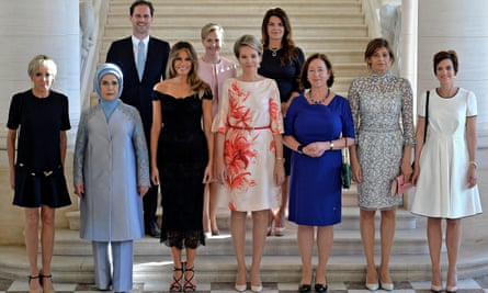 Gauthier Destenay, top left, poses with spouses of Nato leaders including Melania Trump.