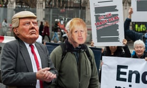 Protesters wearing masks of Donald Trump and Boris Johnson gather outside the Houses of Parliament.