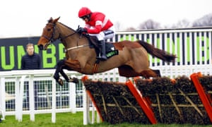 Laurina flies over the hurdle during her easy win at Sandown.