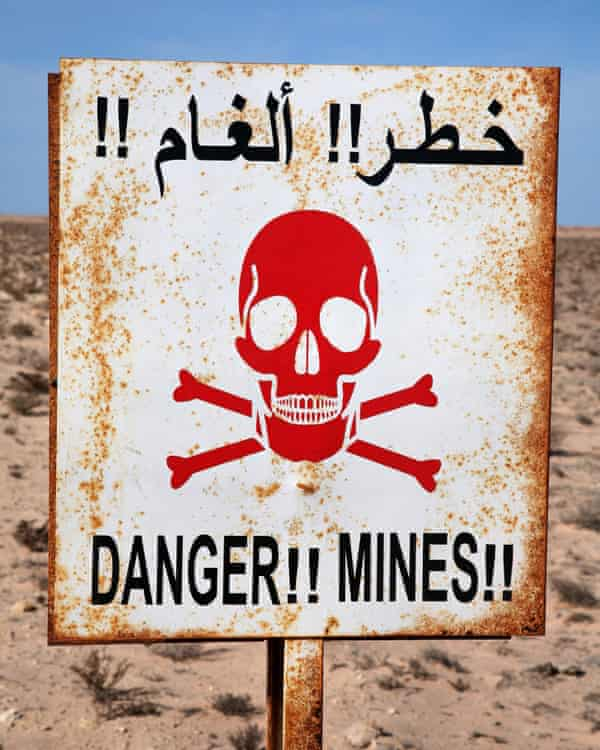 A landmine warning sign in Western Sahara. The desert wall is thought to be the world's longest continuous minefield.