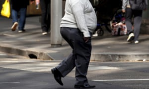 A man crosses a street in Sydney. Despite a reputation for sport and outdoor living, Australia has one of the fattest populations in the world.