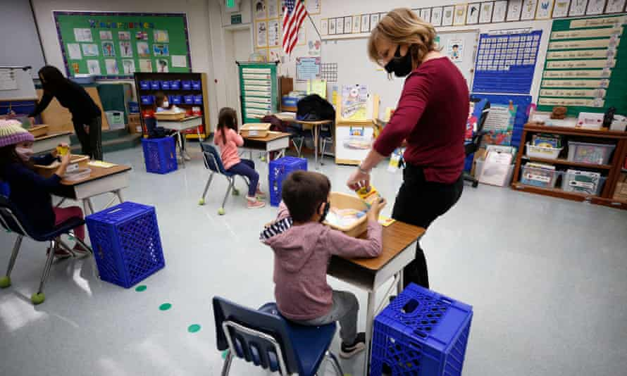 Jennifer Klein, a teacher at Lupine Hill elementary school in Calabasas, California, collects crayons from kindergarten students.