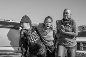 A group of women carry a wounded warrior, Maced by police in November 2016.