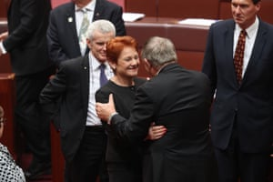 Western Australian Liberal Senator Chris Back is congratulated by One Nation leader Pauline Hanson.