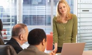 Woman leads meeting in boardroom