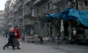 Residents try to escape from airstrikes in Aleppo.