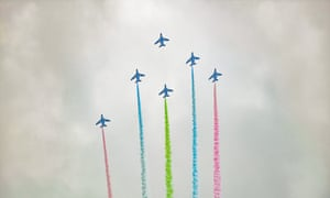 The Japan air acrobatic team performs over the Olympic Stadium.