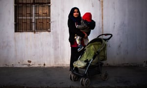 Hoda Muthana and her one-year-old son Adam at the al-Hawl refugee camp in Syria