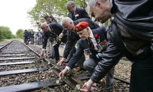 Second world war veterans lay roses on rail tracks near Westerbork, the former Dutch transit camp.