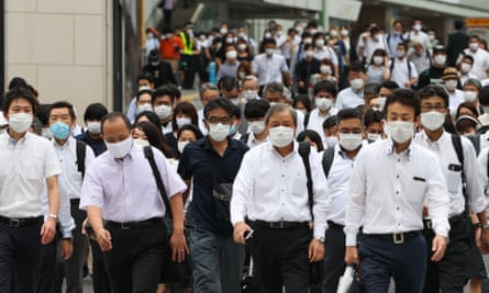 Commuters wearing face masks in Tokyo where there were 237 new cases of coronavirus on Tuesday.