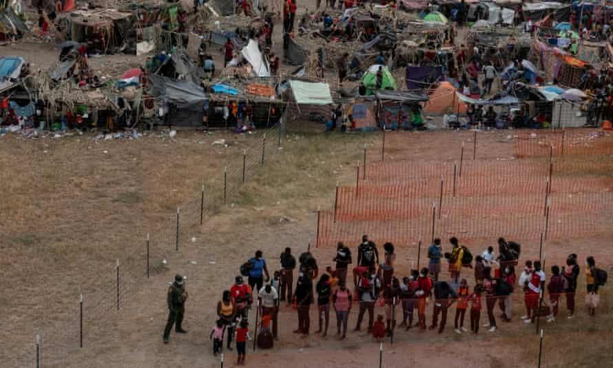 Migrants near the International Bridge in Del Rio, Texas, are prepared for transport.