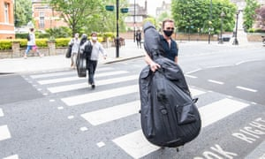 Royal Philharmonic Orchestra musicians arrive at Abbey Road Studios on 4 June 2020.