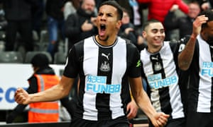 Isaac Hayden celebrates scoring with a late header for Newcastle against Chelsea.