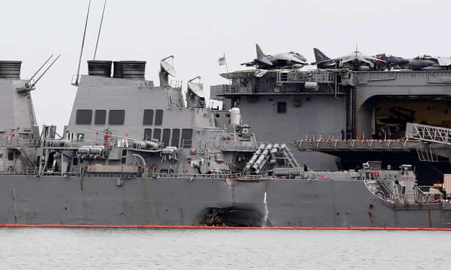 The damaged USS John McCain is docked next to USS America at Changi Naval Base in Singapore.