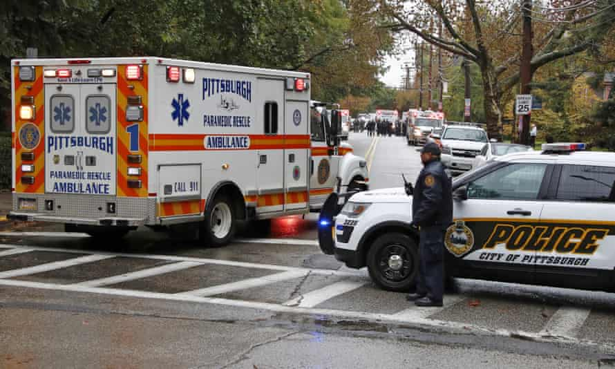 An ambulance arrives at the Tree of Life synagogue where a shooter opened fire.