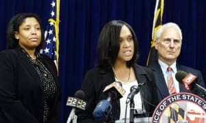 "Baltimore States Attorney Marilyn Mosby, center, announces the indictments of six Baltimore Police officers Thursday, May 21, 2015, on various charges related to the arrest and death of Freddie Gray. The indictments were very similar to the charges Mosby announced about three weeks ago. The most serious charge for each officer, ranging from second-degree ""depraved heart"" murder to assault, still stood. (Kevin Richardson/The Baltimore Sun via AP)"