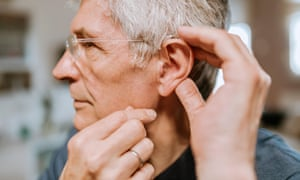 Senior man with hearing aidPG6899 Senior man with hearing aid