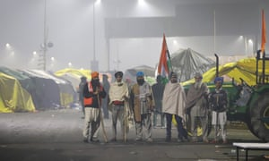 Farmers patrol a protest camp in Ghazipur, on the outskirts of Delhi.
