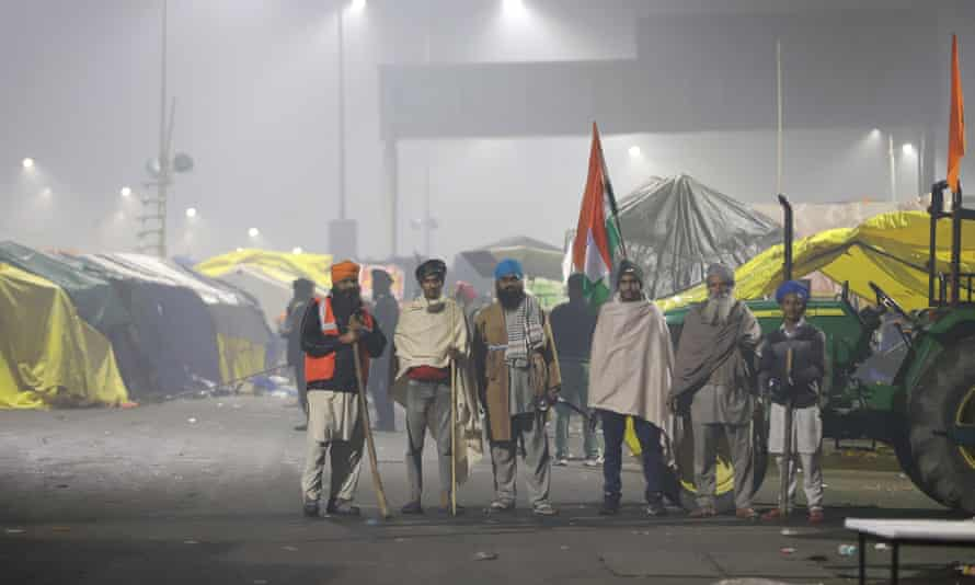 Farmers patrol the site of the protest camp in Ghazipur on the outskirts of Delhi.